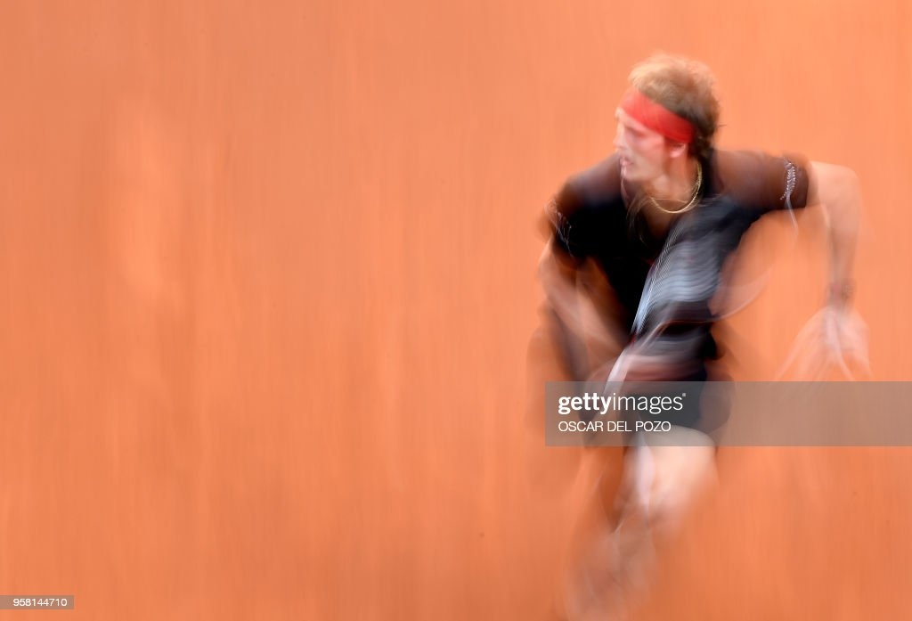 TOPSHOT - Germany's Alexander Zverev returns the ball to Austria's Dominic Thiem during their ATP Madrid Open final tennis match at the Caja Magica in Madrid on May 13, 2018.