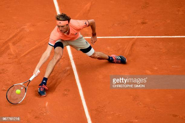 Germany's Alexander Zverev returns the ball to Austria's Dominic Thiem during their men's singles quarterfinal match on day ten of The Roland Garros...