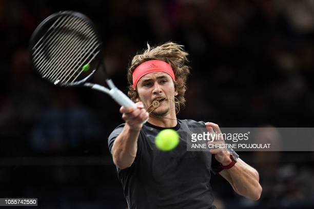 Germany's Alexander Zverev returns the ball to Frances Tiafoe of the US during their men's singles second round tennis match on day three of the ATP...