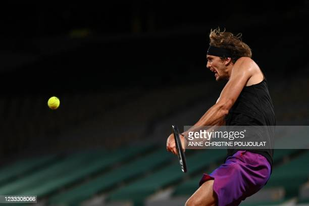 Germany's Alexander Zverev returns the ball to Japan's Kei Nishikori during their men's singles fourth round tennis match on Day 8 of The Roland...