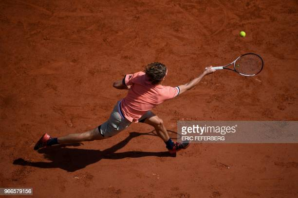 Germany's Alexander Zverev returns the ball to Russia's Karen Khachanov during their men's singles fourth round match on day eight of The Roland...