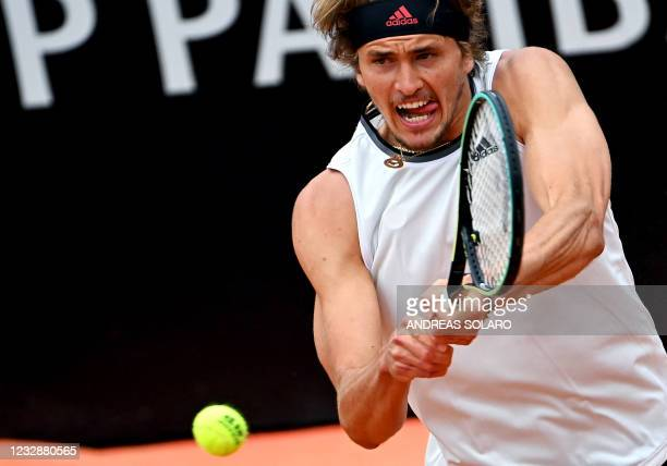 Germany's Alexander Zverev returns the ball to Spain's Rafael Nadal during their tennis match at the Men's Italian Open at Foro Italico on May 14,...
