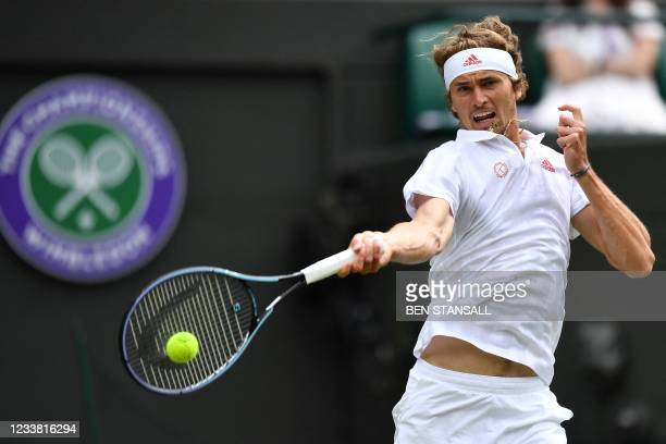 Germany's Alexander Zverev returns to Canada's Felix Auger-Aliassime during their men's singles fourth round match on the seventh day of the 2021...