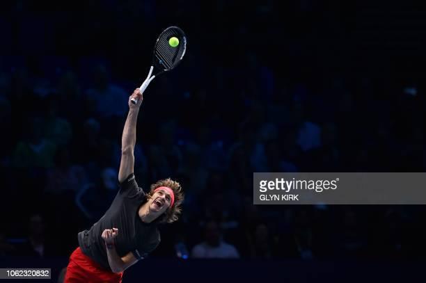 TOPSHOT Germany's Alexander Zverev serves against US player John Isner in their men's singles roundrobin match on day six of the ATP World Tour...