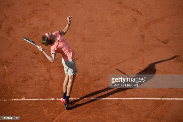 TOPSHOT Germany's Alexander Zverev serves the ball to Lithuania's Ricardas Berankis during their men's singles first round match on day one of The...