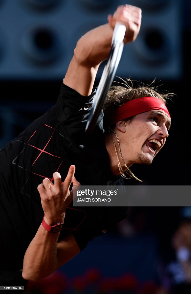 Germany's Alexander Zverev serves to Austria's Dominic Thiem during their ATP Madrid Open final tennis match at the Caja Magica in Madrid on May 13, 2018.