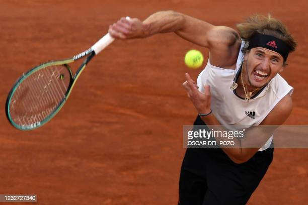 Germany's Alexander Zverev serves to Great Britain's Daniel Evans during their 2021 ATP Tour Madrid Open tennis tournament singles match at the Caja...