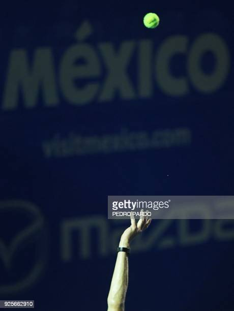 Germany's Alexander Zverev serves to his compatriot Peter Gojowczyk during their Mexico ATP 500 Open men's singles tennis match in Acapulco Guerrero...