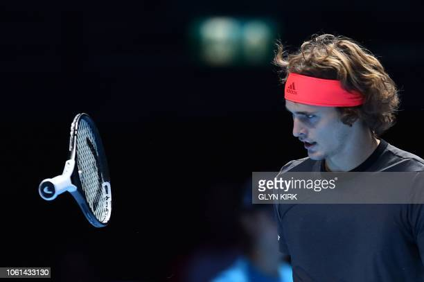 Germany's Alexander Zverev throws his racquet after a point against Serbia's Novak Djokovic during their mens singles roundrobin match on day four of...