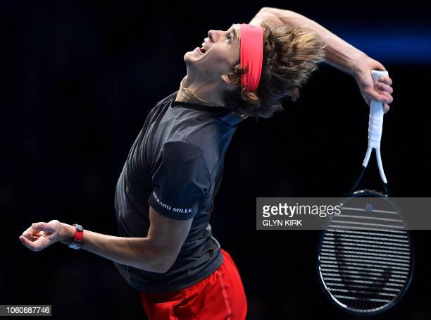 TOPSHOT Germany's Alexander Zverev throws the ball to serve against Croatia's Marin Cilic during their men's singles roundrobin match on day two of...