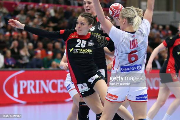 Germany's Alexandra Mazzucco and Norway's Heidi Loeke vie for the ball during the World Women's Handball Championship match between Germany and...