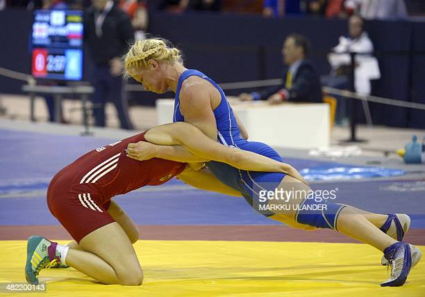 Germany's Aline Focken competes with Sweden's Anna Jenny Eva Maria Fransson in the women's freestyle 69 kg category of the Wrestling European...