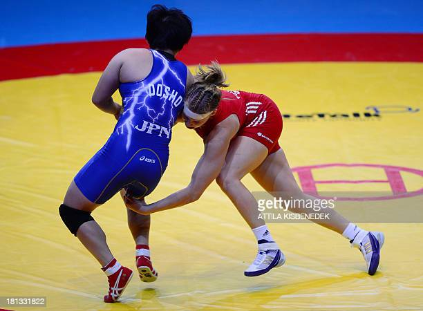 Germany's Aline Focken fights against Japan's Sara Dosho during the women's free style 67 kg category for bronze of the FILA World Wrestling...