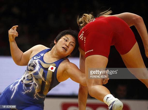 Germany's Aline Focken fights with Japan's Sara Dosho during the bronze round of the women's free style 67 kg category of the World Wrestling...