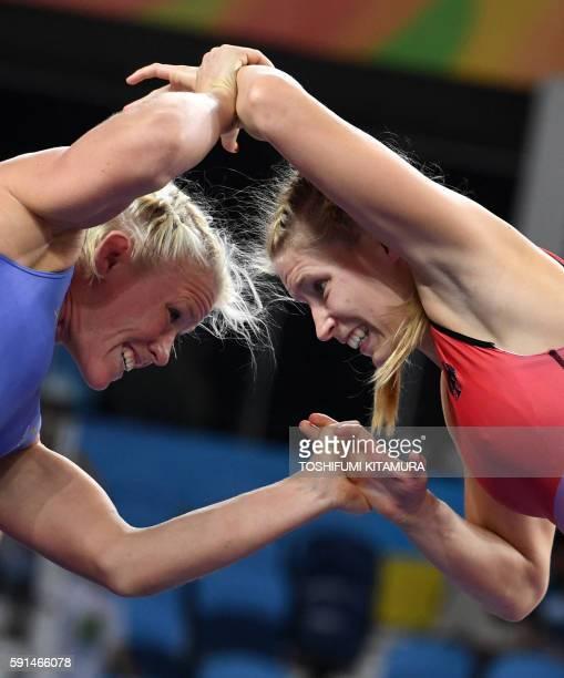 Germany's Aline Focken wrestles Sweden's Anna Jenny Fransson in their women's 69kg freestyle quarterfinal match on August 17 during the wrestling...
