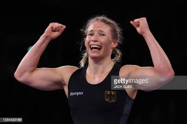 Germany's Aline Rotter Focken reacts after winning gold medal against USA's Adeline Maria Gray in their women's freestyle 76kg wrestling final match...