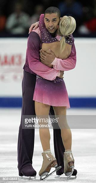 Germany's Aliona Savchenko and Robin Szolkowy celebrate after performing their free skating program at the Scandinavium arena in Gothenburg on March...
