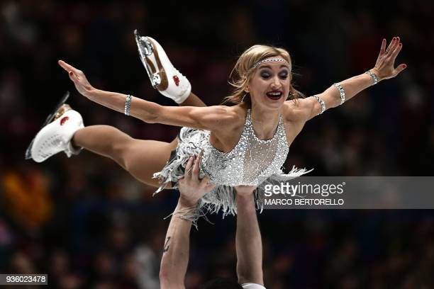 TOPSHOT Germany's Aljona Savchenco and Bruno Massot perform during the Pairs short program at the 2018 World Figure Skating Championship in Milan on...