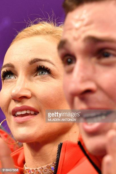 Germany's Aljona Savchenko and Germany's Bruno Massot react after the pair skating free skating of the figure skating event during the Pyeongchang...