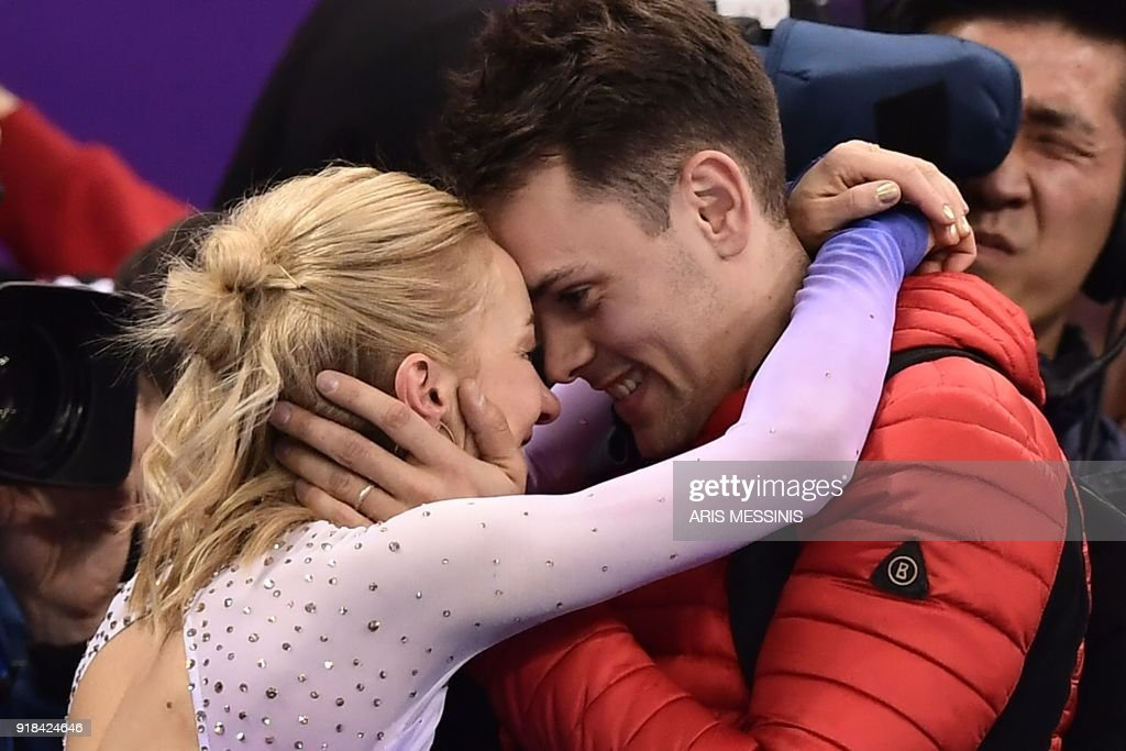 TOPSHOT - Germany's Aljona Savchenko (L) reacts following the pair skating free skating of the figure skating event during the Pyeongchang 2018 Winter Olympic Games at the Gangneung Ice Arena in Gangneung on February 15, 2018. /