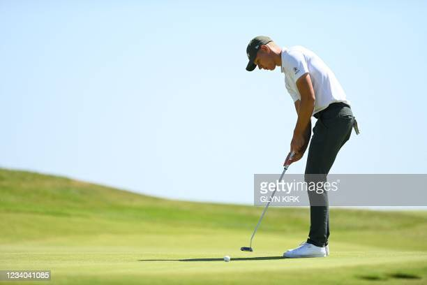 Germany's amateur golfer Matthias Schmid puts on the 12th green during his final round on day 4 of The 149th British Open Golf Championship at Royal...