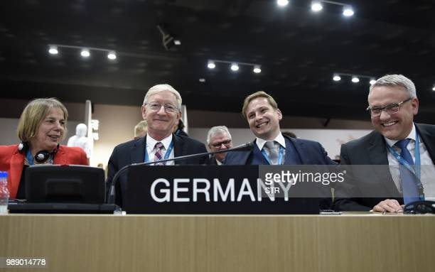 Germanys ambassador to the United Nations Educational Scientific and Cultural Organisation Stefan Krawielicki is seen celebrating with the delegation...