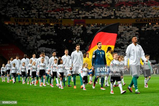 Germany's and Brazil's national football team enter the pitch ahead of the international friendly football match between Germany and Brazil in Berlin...