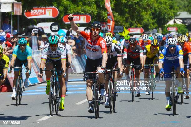 Germany's Andre Greipel from team Lotto Soudal celebrates as he crosses the finish line first on day one of the Tour Down Under cycling race in...