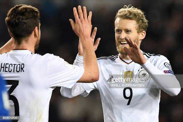 Germany's Andre Schuerrle celebrates with Jonas Hector after scoring a goal during the FIFA World Cup 2018 qualification football match between...