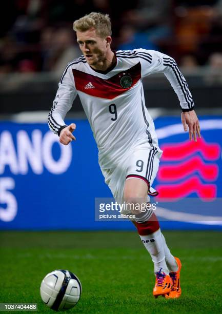 Germany's Andre Schuerrle plays the ball during the International Soccer Match Italy vs Germany at the GiuseppeMeazzaStadion in Mailand Italy 15...