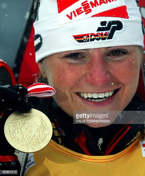 Germany's Andrea Henkel with her goldmedal smiles after her wining the women's 15 km Individual during the IBU Biathlon World championships in...