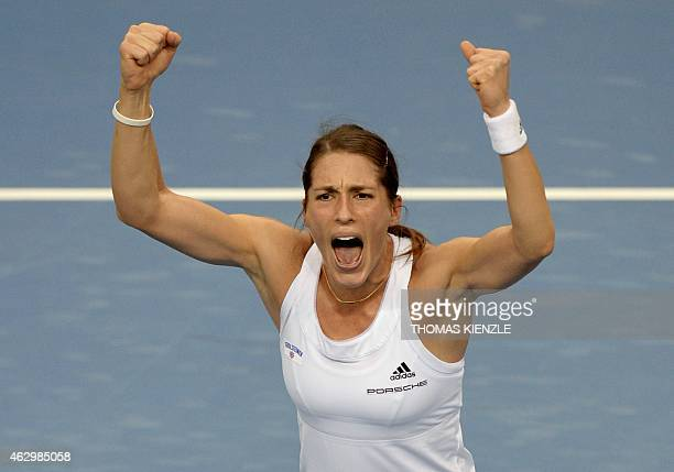 Germany's Andrea Petkovic celebrates after she defeated Australia's Jarmila Gajdosova by 63 36 86 in their tennis match of the FedCup World Group...