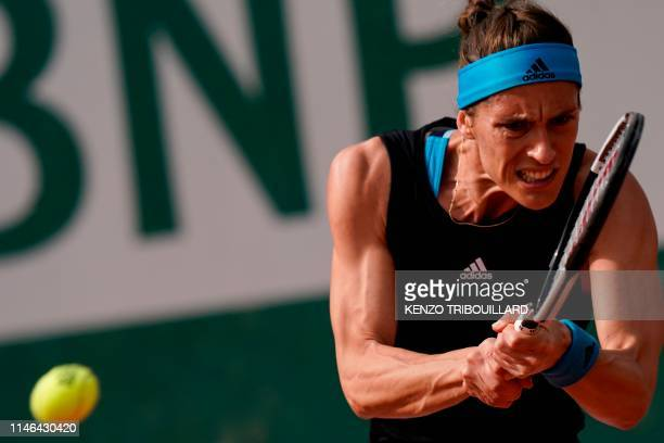 TOPSHOT Germany's Andrea Petkovic returns the ball to Alison Riske of the US during their women's singles first round match on day two of The Roland...