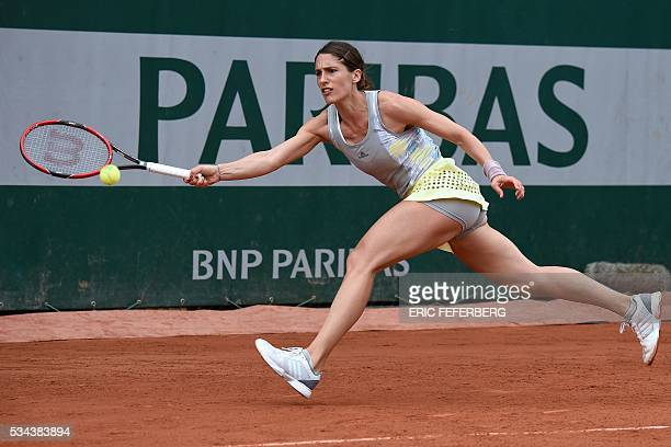 Germany's Andrea Petkovic returns the ball to Kazakhstan's Yulia Putintseva during their women's second round match at the Roland Garros 2016 French...