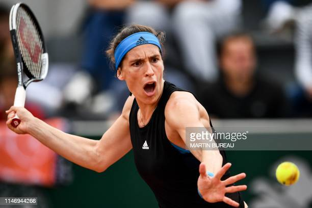 Germany's Andrea Petkovic returns the ball to Taiwan's SuWei Hsieh during their women's singles second round match on day five of The Roland Garros...
