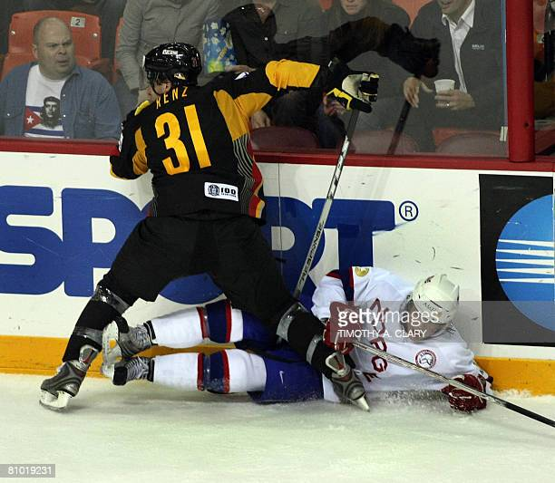 Germany's Andrea Renz checks a player from Norway during the preliminary round of the 2008 IIHF World Hockey Championships at the Halifax Metro...