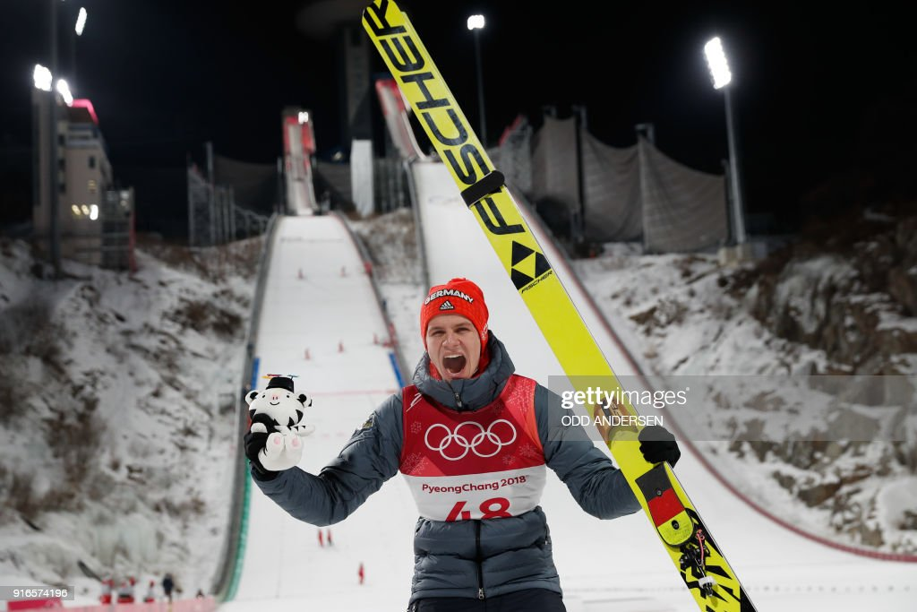 Germany's Andreas Wellinger celebrates during the victory ceremony after winning the men's normal hill individual ski jumping event during the Pyeongchang 2018 Winter Olympic Games on February 10, 2018, in Pyeongchang. / AFP PHOTO / Odd ANDERSEN
