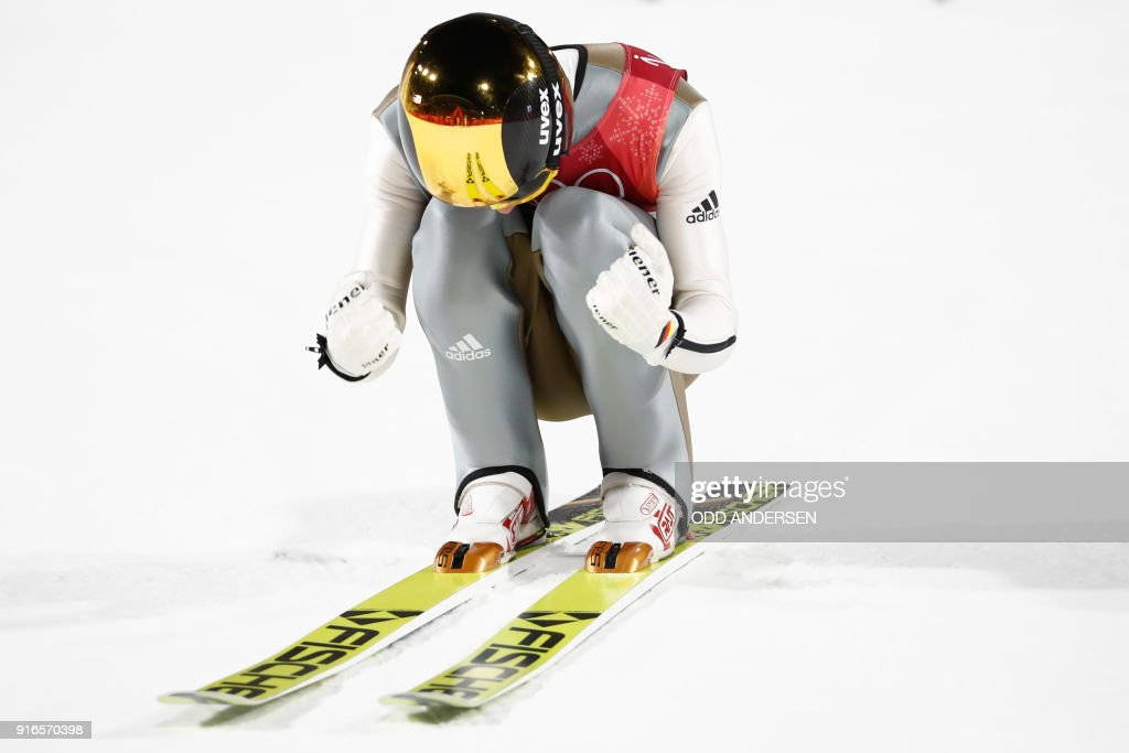 Germany's Andreas Wellinger reacts after competing in the men's normal hill individual ski jumping event during the Pyeongchang 2018 Winter Olympic Games on February 10, 2018, in Pyeongchang. / AFP PHOTO / Odd ANDERSEN