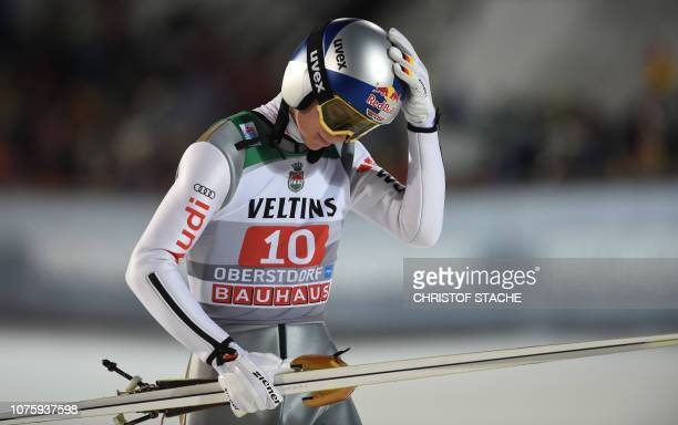 Germany's Andreas Wellinger reacts after his first competition jump of the first stage of the FourHills Ski Jumping tournament in Oberstdorf southern...