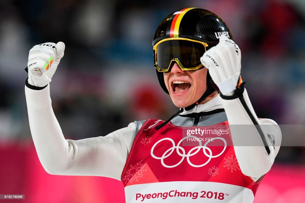 TOPSHOT - Germany's Andreas Wellinger reacts following his final jump to claim silver in the men's large hill individual ski jumping event during the Pyeongchang 2018 Winter Olympic Games on February 17, 2018, in Pyeongchang. /