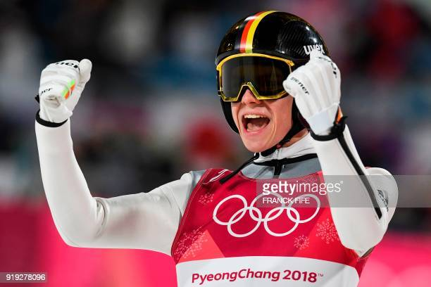 TOPSHOT Germany's Andreas Wellinger reacts following his final jump to claim silver in the men's large hill individual ski jumping event during the...