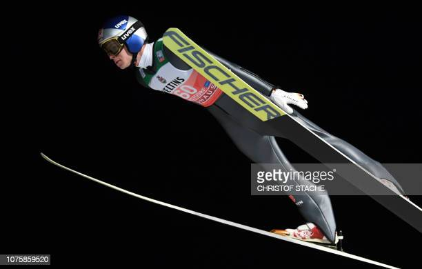 Germany's Andreas Wellinger soars through the air during his qualification jump at the first stage of the FourHills Ski Jumping tournament in...