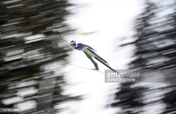 TOPSHOT Germany's Andreas Wellinger soars through the air during his qualification jump at the third stage of the FourHills Ski Jumping tournament in...