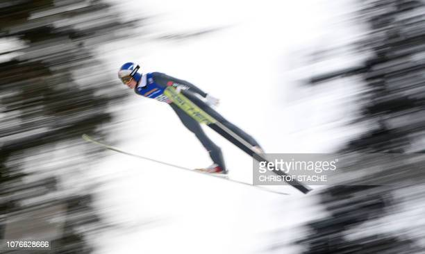 Germany's Andreas Wellinger soars through the air during his qualification jump at the third stage of the FourHills Ski Jumping tournament in...