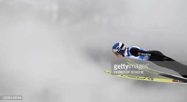 Germany's Andreas Wellinger soars through the air during his training jump at the second stage of the FourHills Ski Jumping tournament in...