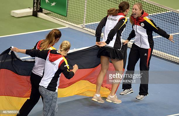 Germany's Angelique Kerber Andrea Petkovic Sabine Lisicki and Julia Goerges celebrate after Petkovic defeated Australia's Jarmila Gajdosova by 63 36...