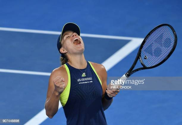 TOPSHOT Germany's Angelique Kerber celebrates after victory over Russia's Maria Sharapova in their women's singles third round match on day six of...