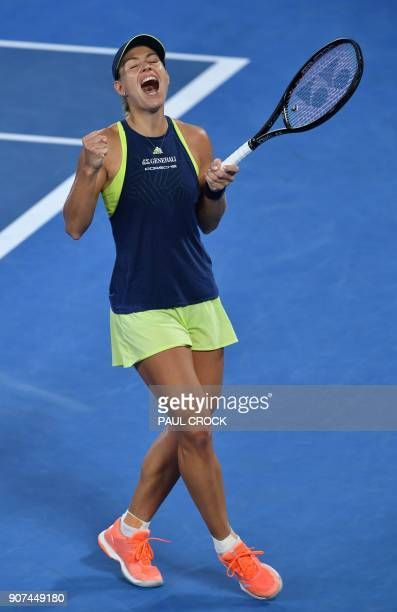 Germany's Angelique Kerber celebrates after victory over Russia's Maria Sharapova in their women's singles third round match on day six of the...