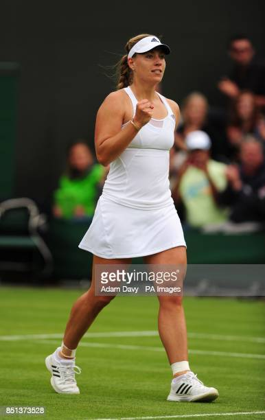 Germany's Angelique Kerber celebrates defeating USA's Bethanie MattekSands during day Two of the Wimbledon Championships at The All England Lawn...
