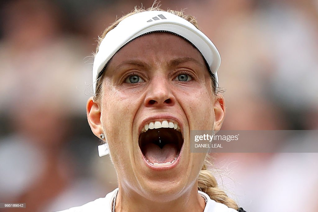 TOPSHOT - Germany's Angelique Kerber celebrates winning a point against Russia's Daria Kasatkina during their women's singles quarter-final match on the eighth day of the 2018 Wimbledon Championships at The All England Lawn Tennis Club in Wimbledon, southwest London, on July 10, 2018. (Photo by Daniel LEAL-OLIVAS / AFP) / RESTRICTED